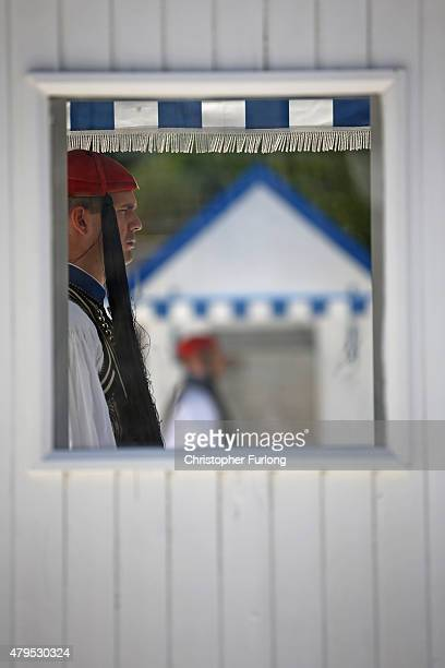 As the people of Greece vote in the referendum an 'Evzones' presidential guard stands in his sentry box outside the Greek parliament on July 5 2015...