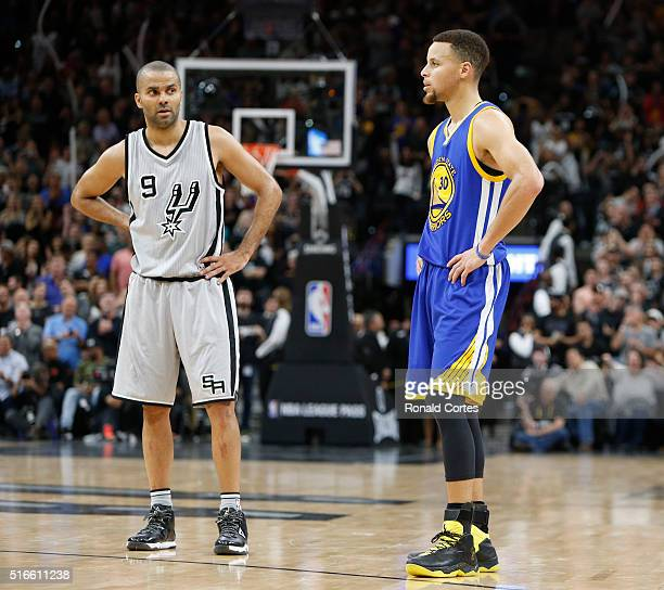 As the seconds tick off Tony Parker of the San Antonio Spurs stand next to Stephen Curry of the Golden States Warriors at ATT Center on March 19 2016...