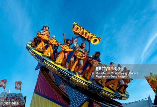 As the sun approaches the horizon warm light falls over the Disko ride on the midway at the 2015 OC Fair ///ADDITIONAL INFORMATION OCFairatdusk Ð...