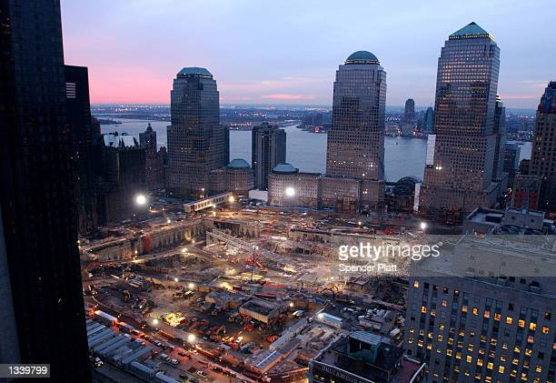 As the sun sets over New Jersey cleanup and recovery efforts continue at the site of the World Trade Center disaster February 15 2002 in New York City