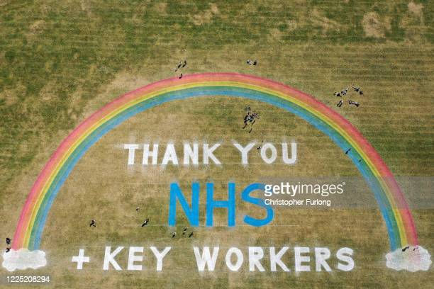 As the UK government ease lockdown restrictions people exercise and view a giant rainbow mural, created by Wirral Council, to thank NHS and key...