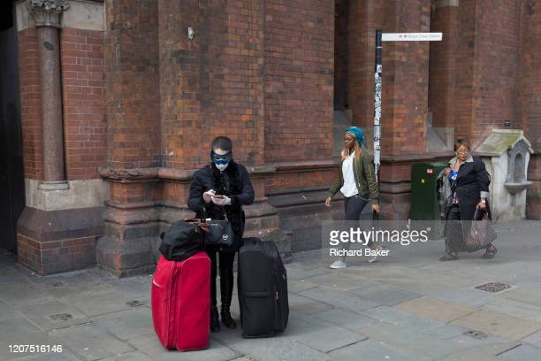 As the UK government urged that all Britons should avoid nonessential travel abroad in order to combat the Coronavirus pandemic in Britain a female...