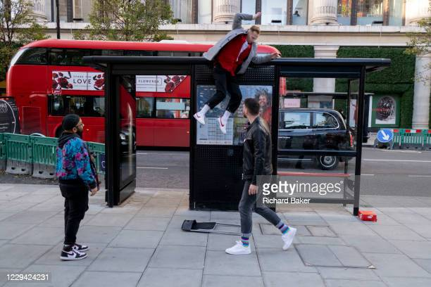 As the UK reacts to Prime Minister Boris Johnson's announcement of Lockdown 2 during the second wave of the Coronavirus pandemic, a man jumps off the...