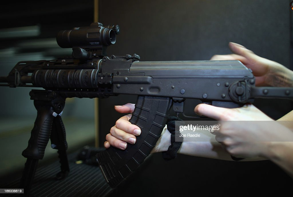 As the U.S. Senate takes up gun legislation in Washington, DC , a weapon is used on the indoor firing range at the National Armory gun store on April 11, 2013 in Pompano Beach, Florida. The Senate voted 68-31 to begin debate on a bill that would significantly expand background checks for gun sales.