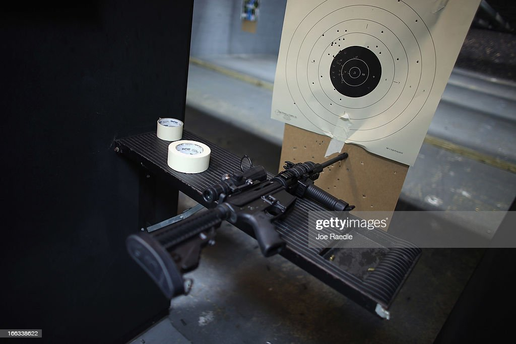 As the U.S. Senate takes up gun legislation in Washington, DC , an AR-15 semi-automatic rifle is seen next to a target in the indoor gun range at the National Armory gun store on April 11, 2013 in Pompano Beach, Florida. The Senate voted 68-31 to begin debate on a bill that would significantly expand background checks for gun sales.