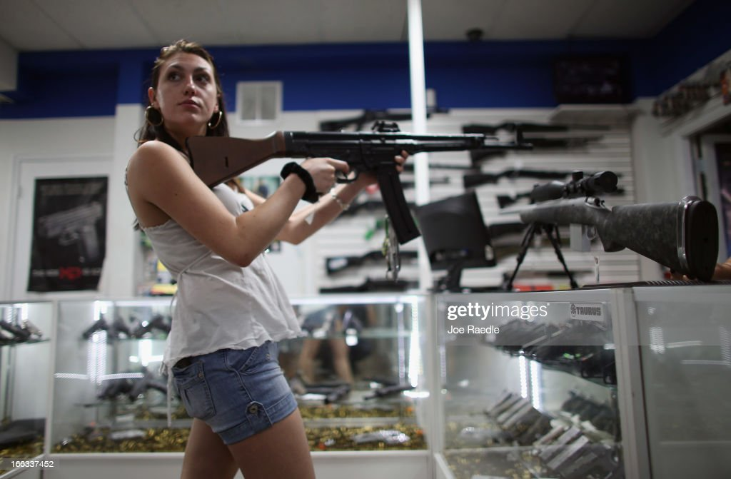As the U.S. Senate takes up gun legislation in Washington, DC , Cristiana Verro browses for guns on sale at the National Armory gun store on April 11, 2013 in Pompano Beach, Florida. The Senate voted 68-31 to begin debate on a bill that would significantly expand background checks for gun sales.