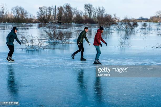 As the wintry weather continues, skaters are taking the chance to skate in one of the frozen lakes close to the Dutch city of Nijmegen, on February...