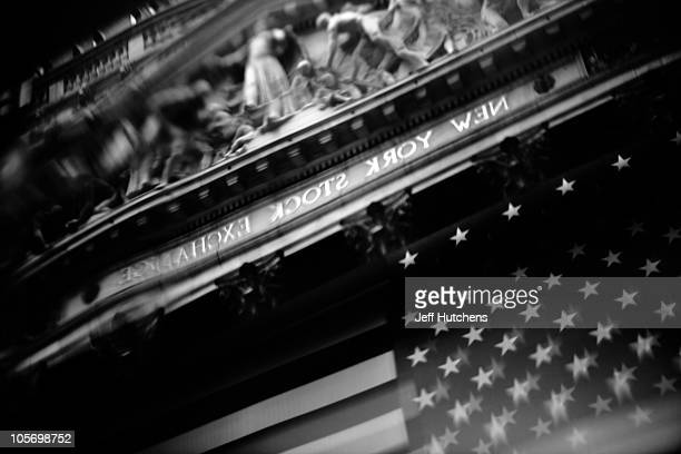 As the world's economy struggles to pull out of a recession the facade of the New York Stock Exchange is reflected in a buidling across the street in...
