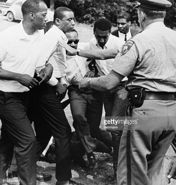 As they attempt to take up James Meredith's march at the point where Meredith was hot civil rights leaders Floyd McKissick Dr Martin Luther King and...