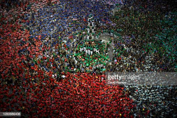 as they built a human tower during the 27th Tarragona Competition on October 07 2018 in Tarragona Spain The 'Castellers' who build the human towers...