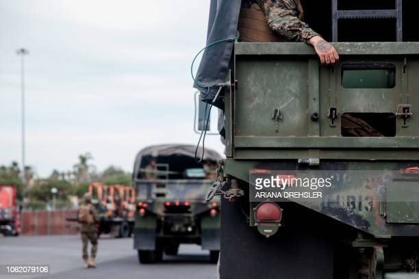 As things unwind for the day members of the US military that were sent out to secure the USMexico Border sit on a truck near Otay Mesa Port of Entry...