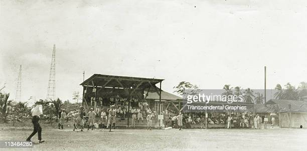 As this real photo postcard shows a baseball game is in progress as part of the July 4 1922 ceremonies in Telo Honduras