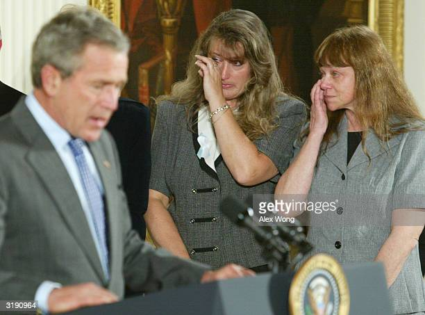 As US President George W Bush speaks mother of unborn victim Tracy Marciniak Seavers and murder victim Christina Renee Alberts' mother Stephanie...