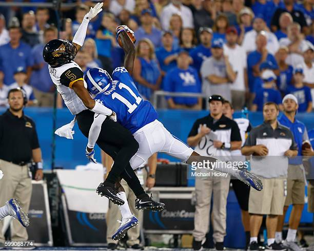 As Walden Davis of the Southern Miss Golden Eagles goes up for the pass but JD Harmon of the Kentucky Wildcats makes the interception at Commonwealth...