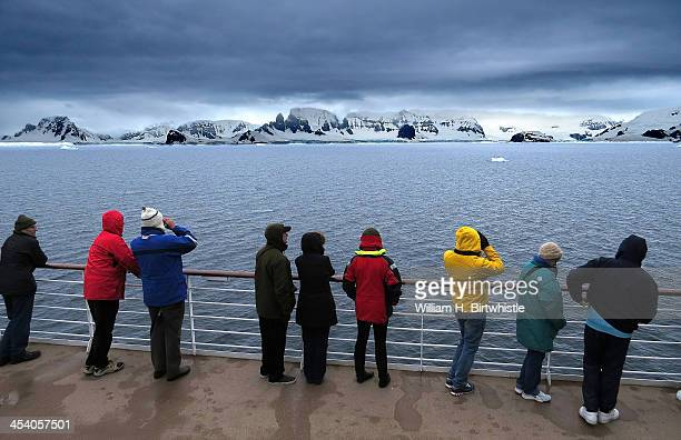 As we first arrived in Antarctica at about two o'clock in the afternoon, cruising slowly between Anvers and Brabant Islands, everyone went up on deck...