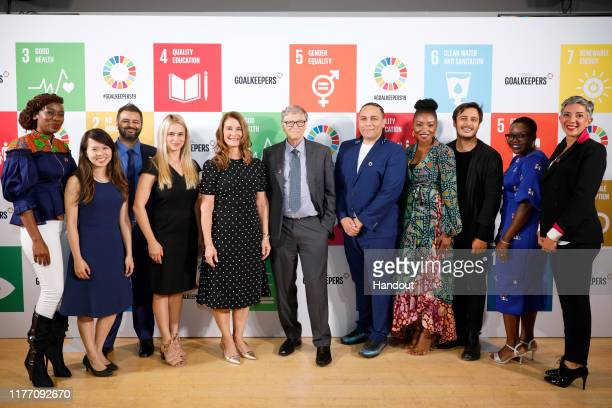 As world leaders gather in New York for the UN General Assembly Melinda Gates and Bill Gates pose with the Goalkeepers Advisory Board during The...