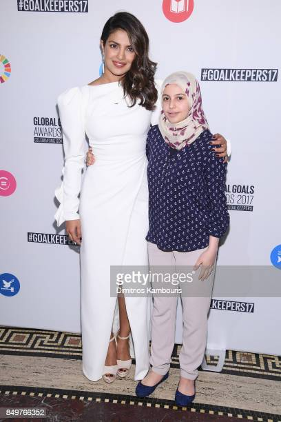 As world leaders gather in New York for the UN General Assembly actress Priyanka Chopra and acivist Muzoon Almellehan attend The Goalkeepers Global...