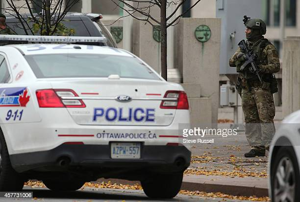 OTTAWA ON OCTOBER 23 As wreath laying ceremonies are performed for Cpl Nathan Cirillo heavily armed RCMP officers watch in the aftermath of a...