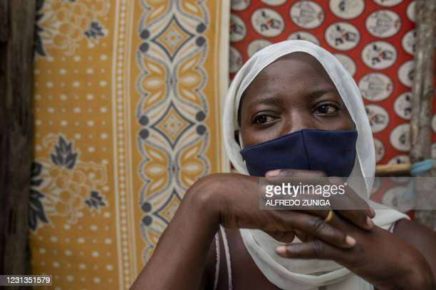 Asa Ambas who moved with her husband and two children to the Paquitequete neighborhood in Pemba City after armed insurgents attacked the Macomia...