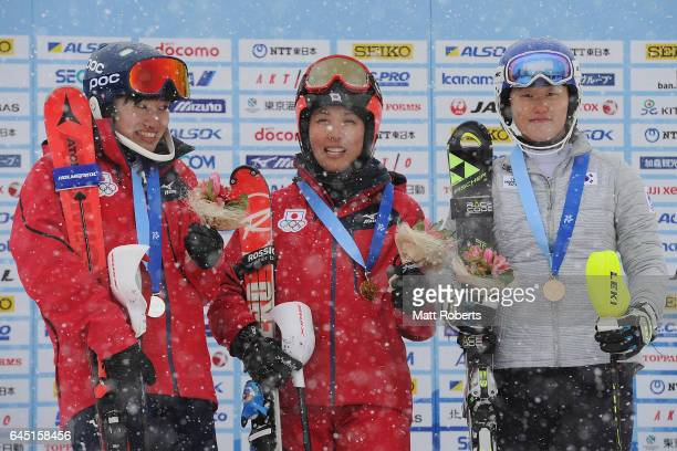 Asa Ando of Japan Emi Hasegawa of Japan and YoungSeo Kang of Korea pose on the podium after the women's slalom alpine skiing on the day eight of the...