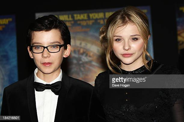 Asa Butterfield and Chloe Moretz attend a Royal film performance of Hugo in 3D at The Odeon Leicester Square on November 28 2011 in London United...