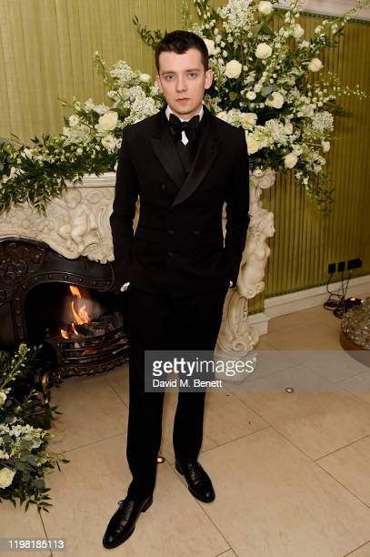 Asa Butterfield attends the British Vogue and Tiffany Co Fashion and Film Party at Annabel's on February 2 2020 in London England