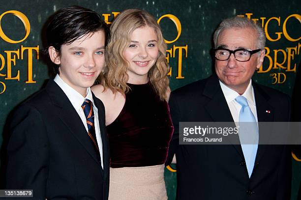 Asa Butterfield Chloe Moretz and Martin Scorsese attend the 'Hugo Cabret 3D' premiere at Cinema UGC Normandie on December 6 2011 in Paris France