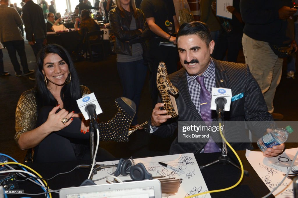 Asa Soltan Rahmati (L) and Reza Farahan interview backstage at the GRAMMYs Dial Global Radio Remotes during The 55th Annual GRAMMY Awards at the STAPLES Center on February 8, 2013 in Los Angeles, California.