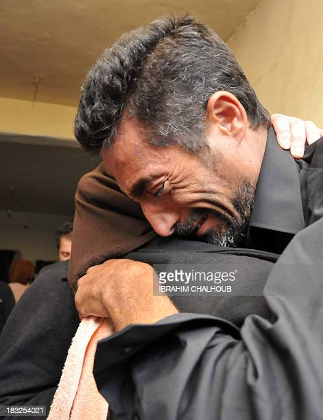 Asaad Asaad a Lebanese survivor of the migrant shipwreck in Indonesia last week is welcomed by relatives as he arrives at their home on October 6...