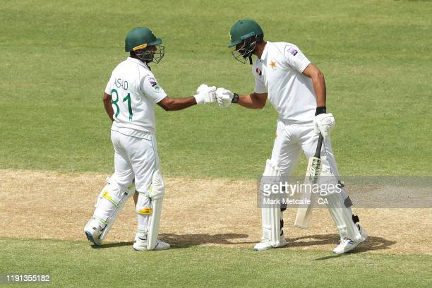 Asad Shafiq and Shan Masood of Pakistan celebrate a century partnership during day four of the Second Test match in the series between Australia and...