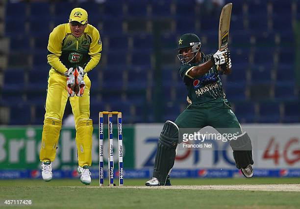 Asad Shafiq of Pakistan bats as Brad Haddin of Australia looks on during the third match of the one day international series between Australia and...