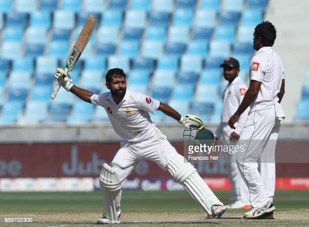 Asad Shafiq of Pakistan celebrates after reaching his century during Day Five of the Second Test between Pakistan and Sri Lanka at Dubai...