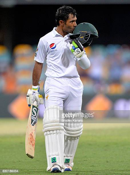Asad Shafiq of Pakistan celebrates after scoring a century during day four of the First Test match between Australia and Pakistan at The Gabba on...