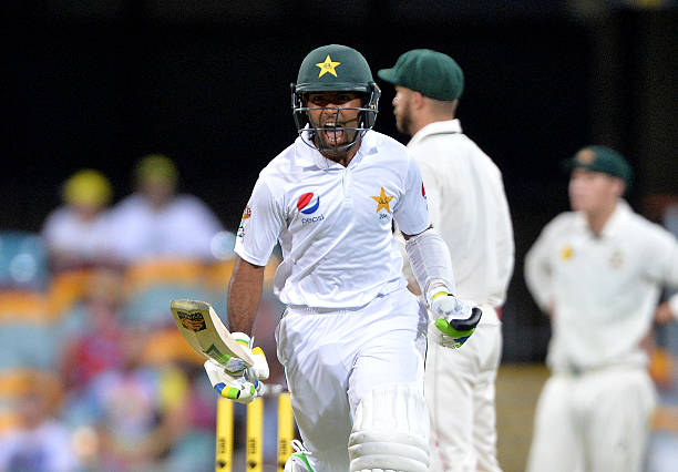 Asad Shafiq of Pakistan celebrates scoring a century during day four of the First Test match between Australia and Pakistan at The Gabba on December...