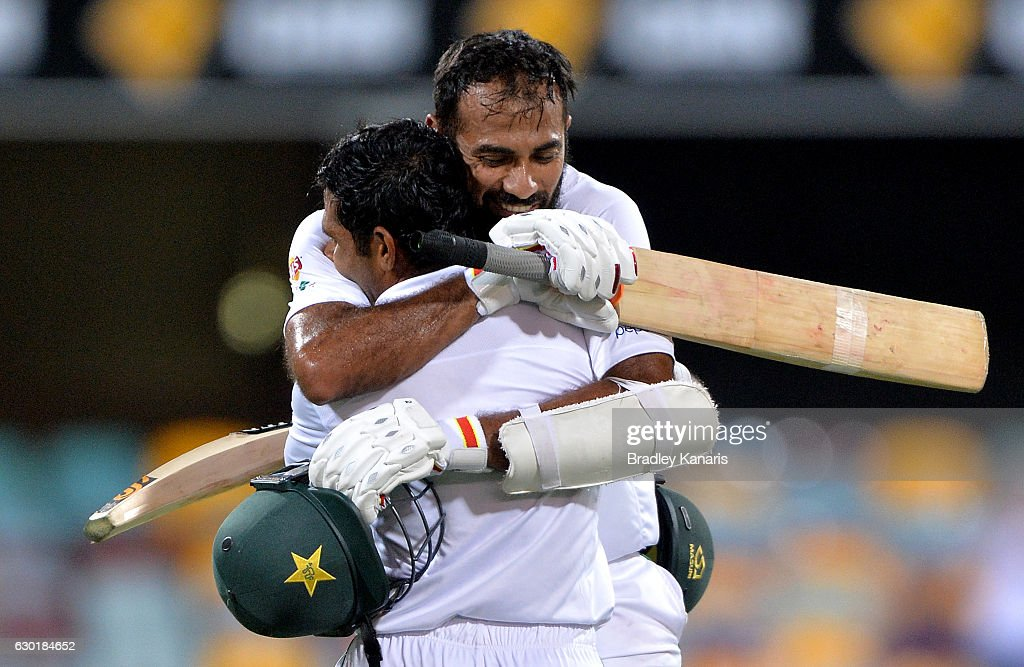 Asad Shafiq of Pakistan celebrates with team mate Wahab Riaz after scoring a century during day four of the First Test match between Australia and Pakistan at The Gabba on December 18, 2016 in Brisbane, Australia.