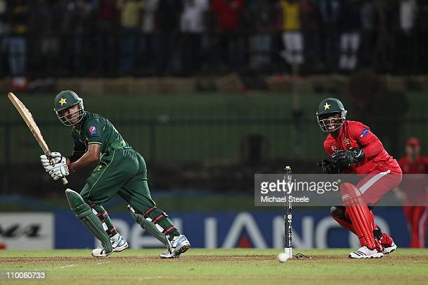 Asad Shafiq of Pakistan plays behind square as wicketkeeper Tatenda Taibu looks on during the Pakistan v Zimbabwe 2011 ICC World Cup Group A match at...