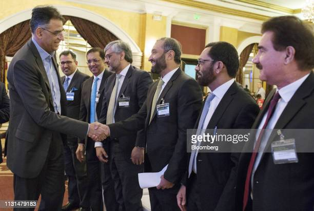 Asad Umar Pakistan's minister of finance shakes hands with Ghias Khan chief executive officer of Engro Corp as he arrives at the Bloomberg Pakistan...