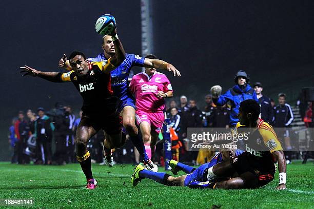 Asaeli Tikoirotuma of the Chiefs tries to control the pass from teammate Save Tokula during the round 13 Super Rugby match between the Chiefs and the...
