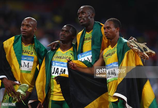 Asafa Powell Nesta Carter Usain Bolt and Michael Frater of Jamaica celebrate the gold medal after the Men's 4 x 100m Relay Final at the National...