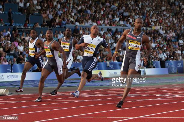 Asafa Powell of Jamaca crosses the line to win the 100 metres final during the Norwich Union London Grand Prix meeting at Crystal Palace Athletics...