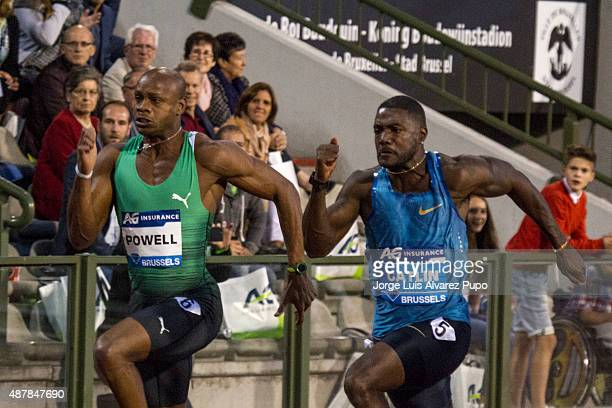 Asafa Powell of Jamaica and Justin Gatlin of United States compete in the Men's 100m during the AG Insurance Memorial Van Damme as part of the IAAF...