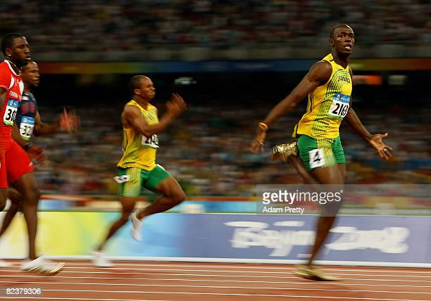 Asafa Powell of Jamaica and Usain Bolt of Jamaica compete in the Men's 100m Final at the National Stadium on Day 8 of the Beijing 2008 Olympic Games...