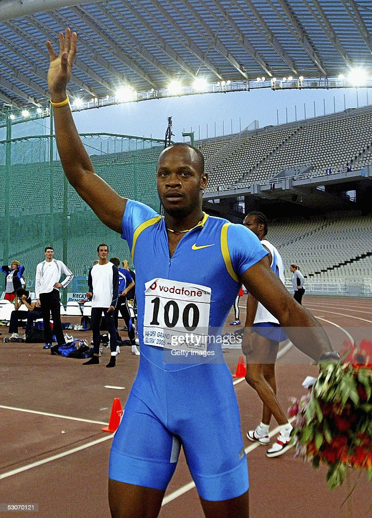 Asafa Powell of Jamaica celebrates after winning the men's 100m event at the Athens Super Grand Prix at the Olympic Stadium June 14, 2005 in Athens, Greece. Powell set a new world record time of 9.77 seconds, breaking the previous record of 9.78 seconds held by Tim Montgomery of USA.