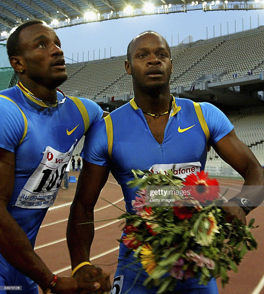 Asafa Powell (R) of Jamaica celebrates with countryman Patrick Jarret after winning the men's 100m event at the Athens Super Grand Prix at the Olympic Stadium June 14, 2005 in Athens, Greece. Powell set a new world record time of 9.77 seconds, breaking the previous record of 9.78 seconds held by Tim Montgomery of USA.