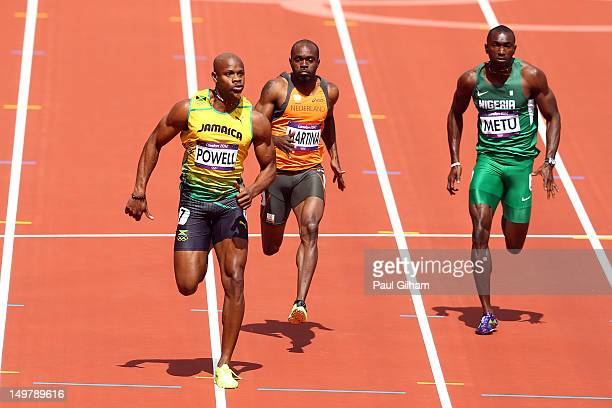 Asafa Powell of Jamaica Churandy Martina of Netherlands and Obinna Metu of Nigeria compete in the Men's 100m Round 1 Heats on Day 8 of the London...