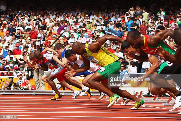 Asafa Powell of Jamaica competes in the Men's 100m Heats at the National Stadium on Day 7 of the Beijing 2008 Olympic Games on August 15, 2008 in...