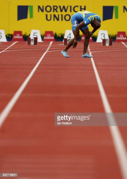 Asafa Powell of Jamaica falls over during the 100m Mens Fianl at the Norwich Union Grand Prix meeting on July 22, 2005 at Crystal Palace Athletics...