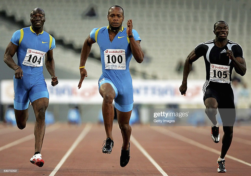 Asafa Powell (C) of Jamaica leads Francis Obikwelu (L) of Portugal and Aziz Zakari of Ghana in the men's 100m event at the Athens Super Grand Prix at the Olympic Stadium June 14, 2005 in Athens, Greece. Powell set a new world record time of 9.77 seconds, breaking the previous record of 9.78 seconds held by Tim Montgomery of USA.