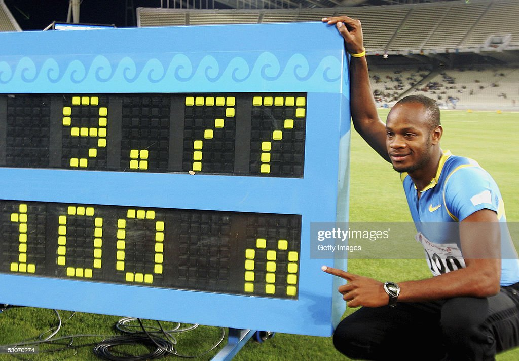 Asafa Powell of Jamaica poses with the electronic scoreboard after winning the men's 100m event in a new world record time at the Athens Super Grand Prix at the Olympic Stadium June 14, 2005 in Athens, Greece. Powell set a new world record time of 9.77 seconds, breaking the previous record of 9.78 seconds held by Tim Montgomery of USA.