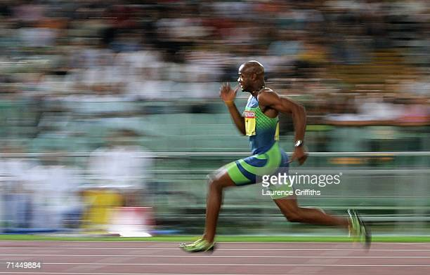 Asafa Powell of Jamaica runs to victory in the Mens 100m during the IAAF Golden League Golden Gala meeting on July 14, 2006 at the Olympic Stadium in...